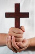 hands-holding-a-cross